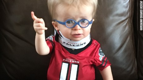 Wyatt Keeton captured hearts after an Atlanta hospital shared this photo on Facebook. The 17-month-old boy with dwarfism was instantly dubbed the Falcons cutest fan.