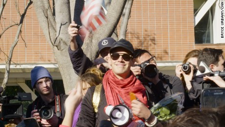"Milo Yiannopoulos leads a march on the UC Davis campus after his speaking event was canceled due to ""security concerns."""