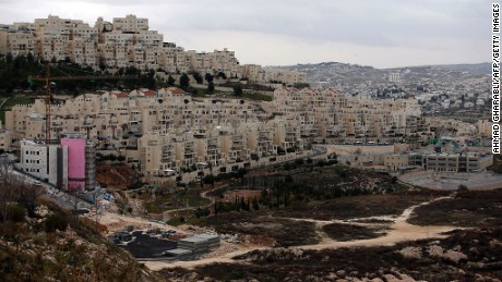 A picture taken on January 26, 2017 shows new apartments under construction in the Israeli settlement of Har Homa (foreground-L) situated in East Jerusalem, in front of the West Bank city of Bethlehem (background-R) Israeli officials gave final approval Thursday to 153 east Jerusalem settler homes, the deputy mayor said, adding to a sharp increase in such projects since US President Donald Trump took office.