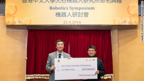 Xiao Jianhua (R) giving a donation check to Chinese University of Hong Kong President Professor Joseph Sung  in April 2016.