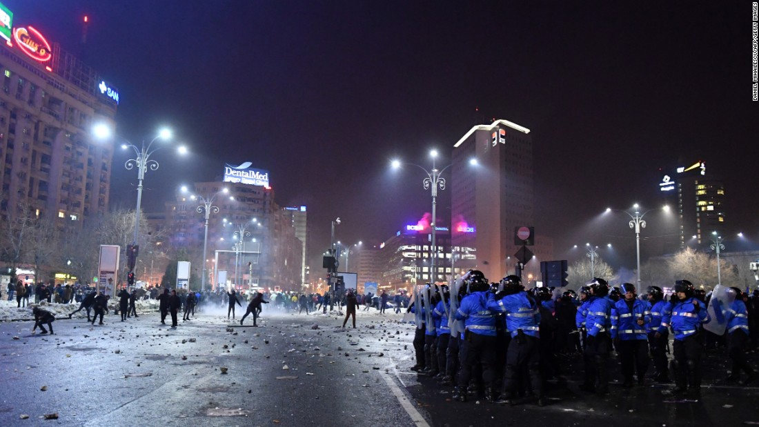 Police and demonstrators face off February 1 in Bucharest. Some people threw flares and other objects at security forces.