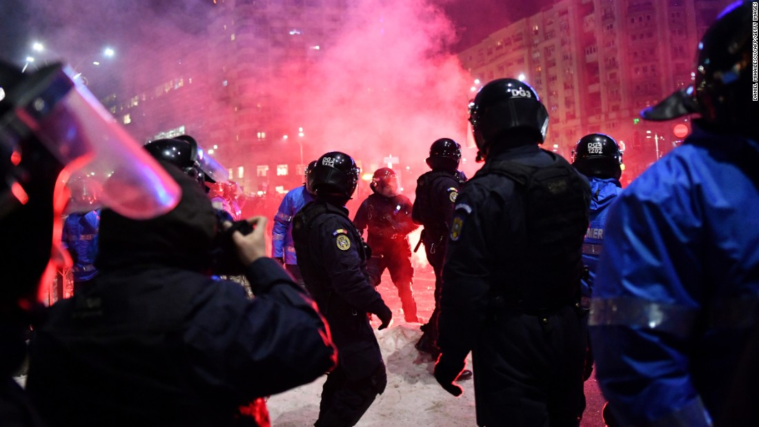Riot police and protesters clash February 1 in Bucharest.