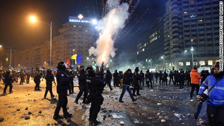 Riot police fire tear gas during protests in Bucharest on February 1.