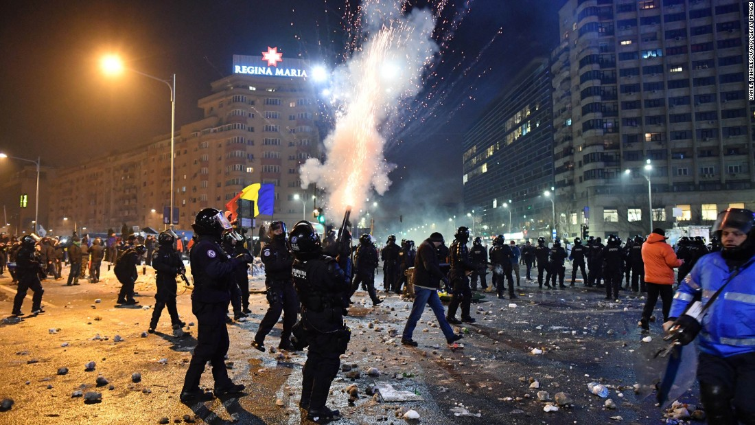 Riot police try to disperse demonstrators with tear gas February 1 in Bucharest. If it had gone into effect, the new law would have stopped ongoing investigations for corruption offenses and would prevent the launching of any subsequent probes.