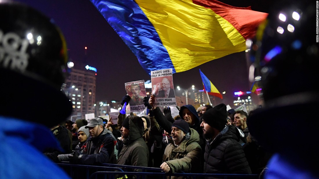 People wave flags in opposition to the government's decree February 1 in Bucharest. The embassies of Belgium, Canada, France, Germany, the Netherlands and the United States issued a joint statement expressing concern over the Romanian government's actions. The European Commission president also voiced worry.