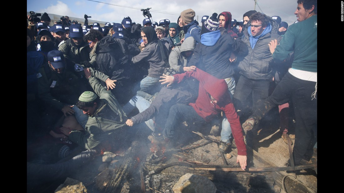 "Israeli police clash with protesters in the West Bank outpost of Amona on Wednesday, February 1. <a href=""http://www.cnn.com/2017/02/01/middleeast/settlements-explainer/index.html"" target=""_blank"">In contrast to settlements</a>, which are authorized by the Israeli government, outposts like Amona are illegally built villages which have not been recognized or authorized by the Israeli government. About 3,000 members of Israeli security forces were deployed to evacuate Amona, <a href=""http://www.cnn.com/2017/02/01/middleeast/israel-settlements-approved/index.html"" target=""_blank"">said police spokeman Micky Rosenfeld</a>. And while some families left peacefully, there were clashes between police and about 1,000 protesters. The evacuation of Amona came the same day Prime Minister Benjamin Netanyahu announced plans for the construction of a new settlement."