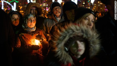 People gather in remembrance of the victims of Sunday's shooting at a Quebec City mosque, during a vigil in Edmonton, Alberta, Monday, Jan. 30, 2017.