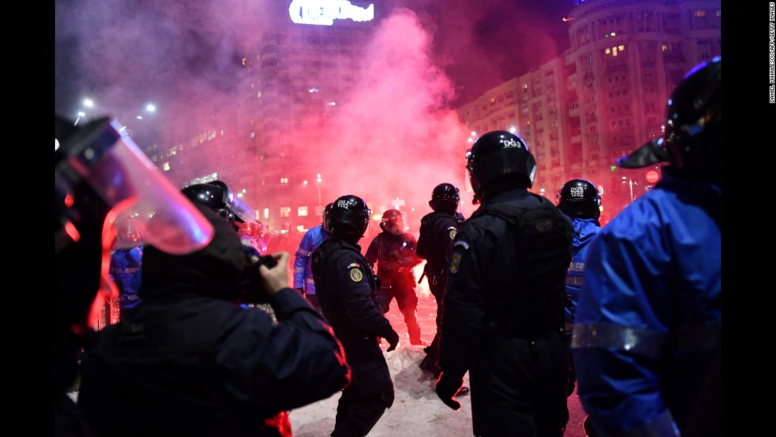 "Romanian riot police clash with protesters during a demonstration in front of the government headquarters in Bucharest on Wednesday, February 1. People have been <a href=""http://www.cnn.com/2017/02/01/europe/romania-protests/"" target=""_blank"">protesting recent decrees adopted by the government</a>, including one which decriminalizes corruption that causes damage worth less than about $48,000 US (200,000 leu), and another which could free some officials who are in prison for corruption."