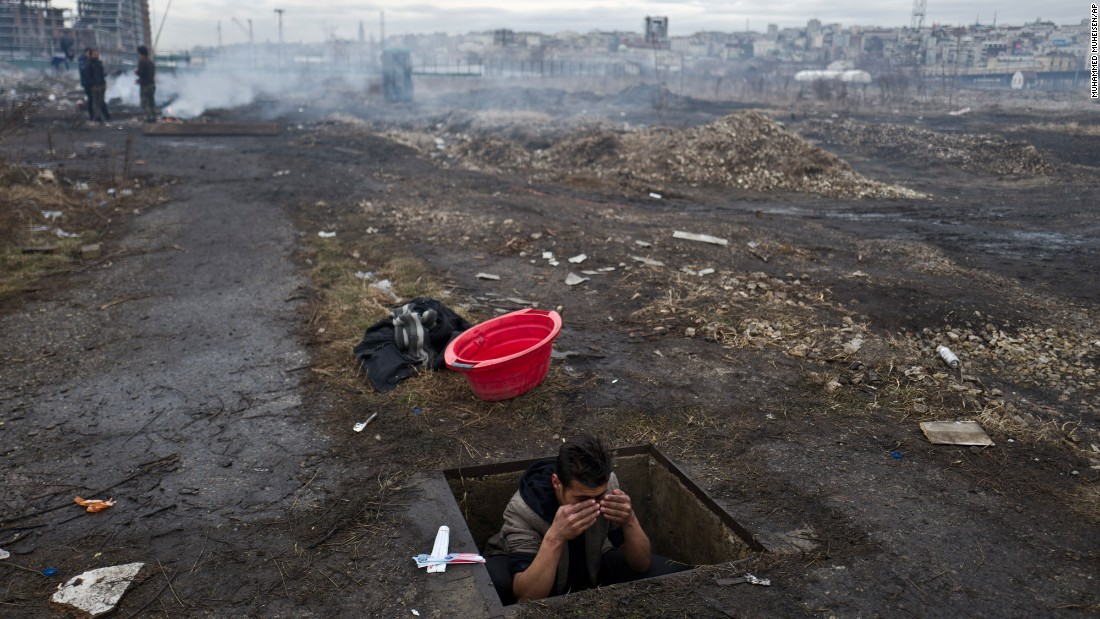 "An Afghan refugee washes himself in a hole in the ground outside an old train carriage where he and other migrants took refuge in Belgrade, Serbia, on Thursday, February 2. For the past month, refugees and migrants have been <a href=""http://www.cnn.com/2017/01/11/europe/refugees-belgrade-europe-cold-snap/index.html"" target=""_blank"">trying to survive the freezing winter</a>, with many seeking shelter in crumbling buildings with broken windows, no heating or warm water."