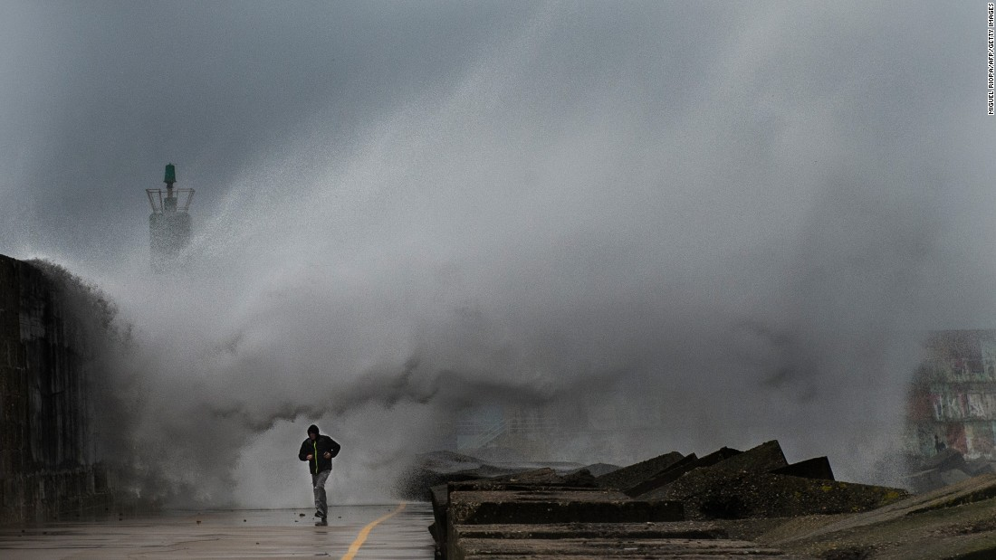 A large wave hits the pier of the A Guarda port in northwestern Spain during a storm on Thursday, February 2.