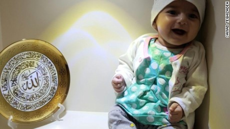 Iranian baby barred by travel ban arrives at hospital