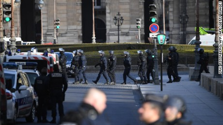 "Policemen patrol near the Louvre museum on February 3, 2017 in Paris, after a soldier patrolling at the museum shot and seriously injured a machete-wielding man who yelled ""Allahu Akbar"" (""God is greatest"") as he attacked security forces, police said. One soldier was ""lightly injured"" and has been taken to hospital, while the knifeman is in a serious condition but is still alive, security forces said. / AFP / Eric FEFERBERG        (Photo credit should read ERIC FEFERBERG/AFP/Getty Images)"