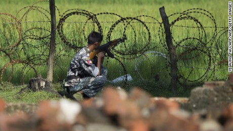 An armed Myanmar border police scans the border area during a patrol in Maungni village in Maungdaw along the river dividing Myanmar and Bangladesh border located in Rakhine State on October 15, 2016. A Pakistani Taliban-trained militant leader was behind deadly attacks in the north of Myanmar's Rakhine state that have sparked a military crackdown and sent thousands of terrified residents fleeing the area, Myanmar's president said on October 15. / AFP / YE AUNG THU        (Photo credit should read YE AUNG THU/AFP/Getty Images)