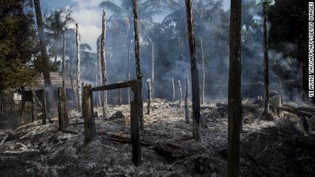 Smouldering debris of burned houses is seen in Warpait village, a Muslim village in Maungdaw located in Rakhine State on October 14, 2016 as the government announced that terror groups were behind the series of attacks Towns and villages across northern Rakhine state were deserted on October 14, as terrified residents fled a deadly military crackdown on foot and by air, fearing Myanmar's restive western state could once again be ripped apart by violence. / AFP / YE AUNG THU        (Photo credit should read YE AUNG THU/AFP/Getty Images)