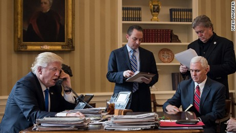 President Trump speaks on the phone with Russian President Vladimir Putin in the Oval Office on January 28. Pictured, from left, are White House Chief of Staff Reince Priebus, Vice President Mike Pence, and White House Chief Strategist Steve Bannon.