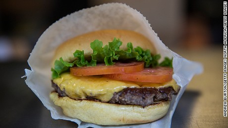 NEW YORK, NY - AUGUST 18: A Shake Shack burger is displayed on August 18, 2014 in Madison Square Park in New York City. Shake Shack is allegedly considering going public and holding an initial price offering (IPO).  (Photo by Andrew Burton/Getty Images)