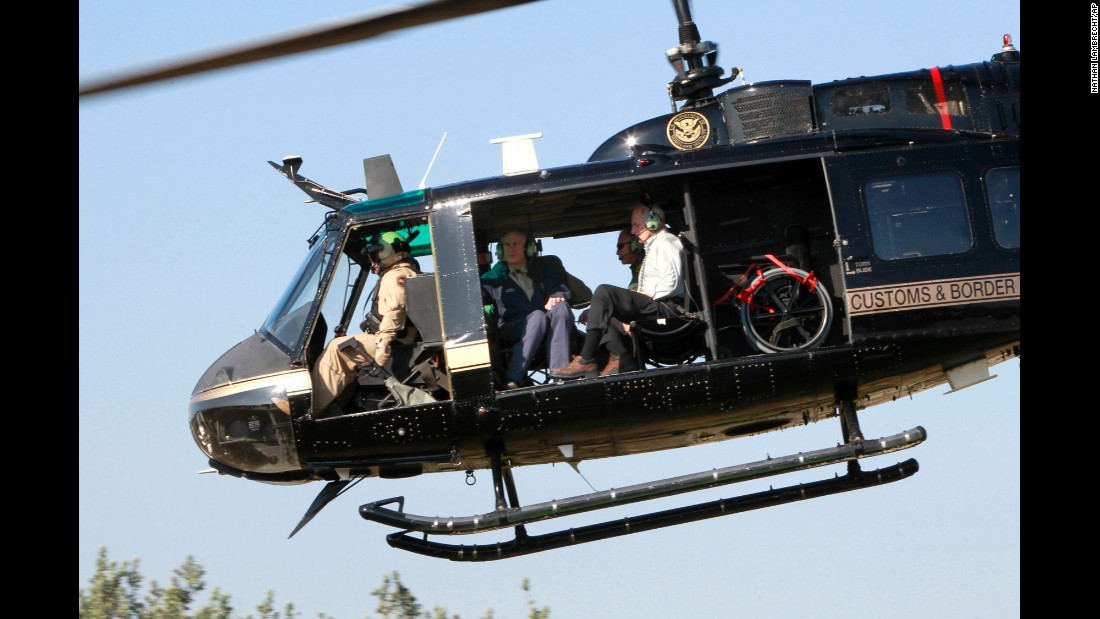 Homeland Security Secretary John Kelly, right, takes a helicopter tour of the Texas-Mexico border on Wednesday, February 1. He was joined by Texas Gov. Greg Abbott, center.