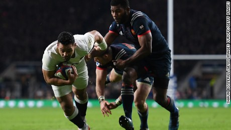 Ben Te'o of England dives to score his side's first try.