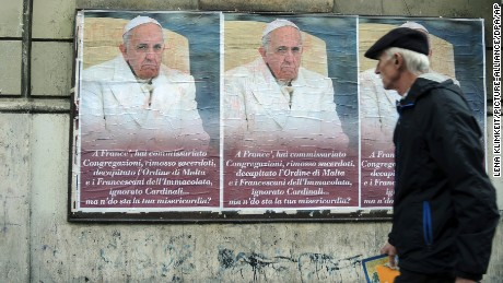 "Posters criticizing Pope Francis on a wall in Rome, Italy, February 4, 2017. The poster reads, ""You've put congregations under supervision, removed priests, decapitated the Maltese and Franciscan orders and ignored cardinals... But where is your compassion?"""