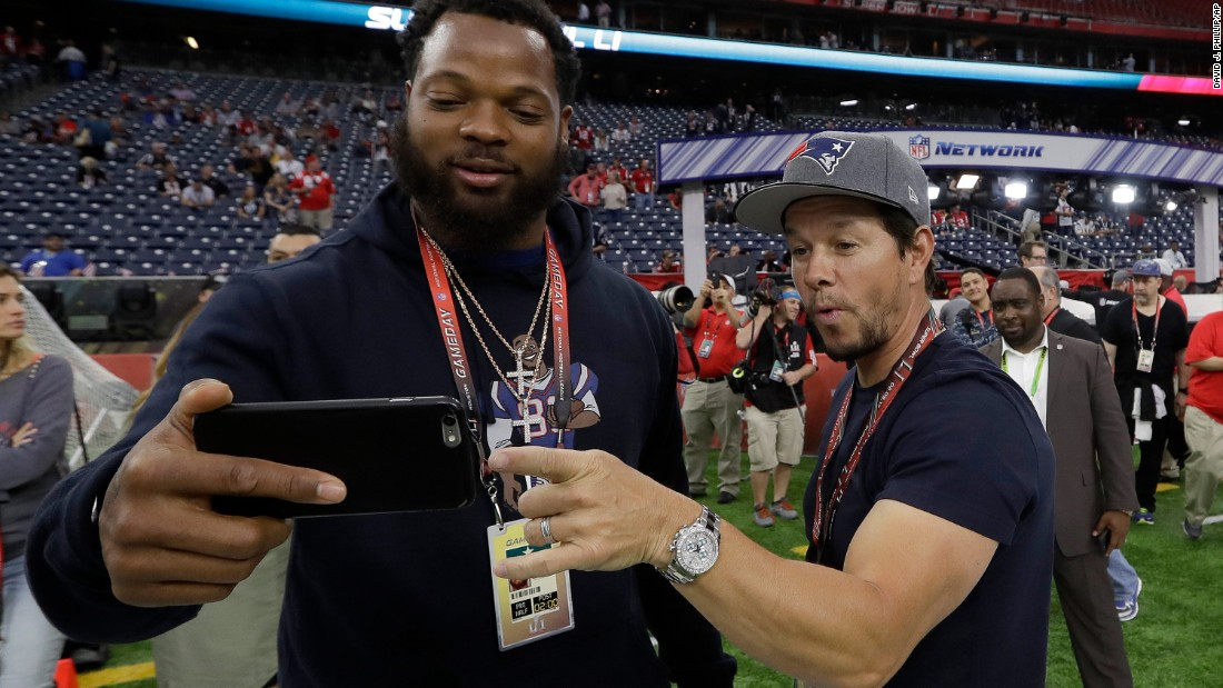 Seattle defensive end Michael Bennett takes a selfie with actor Mark Wahlberg before the game. Bennett's brother Martellus plays for the Patriots. Wahlberg is a Patriots fan.