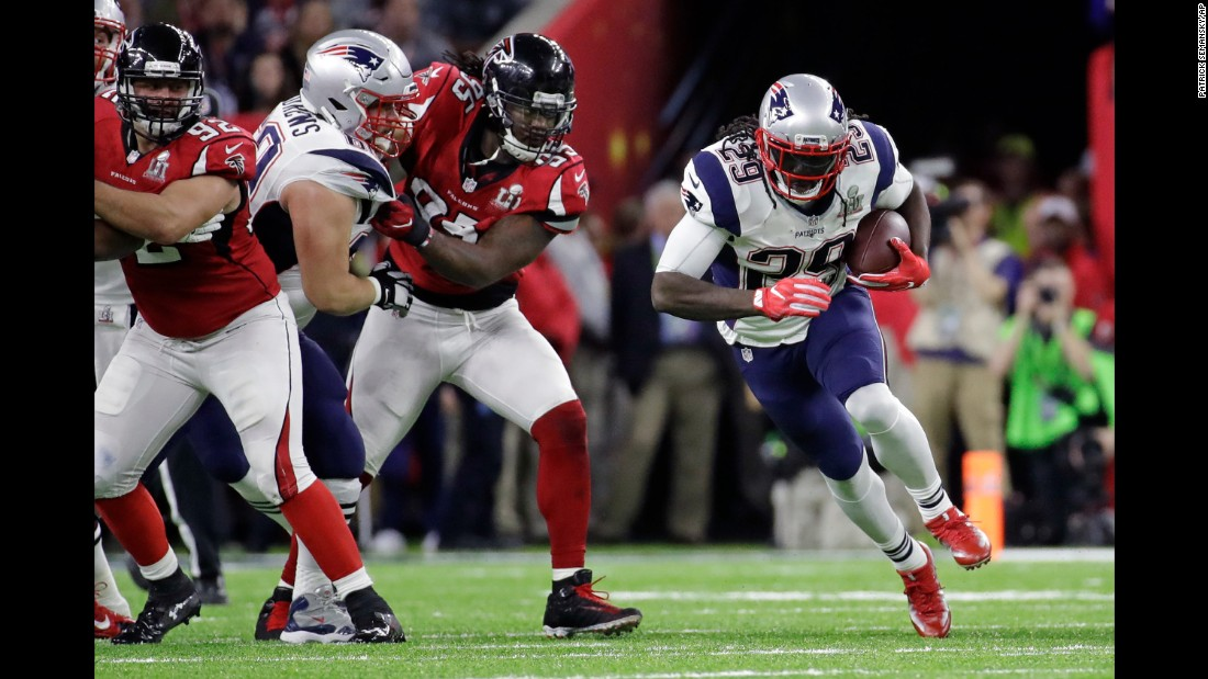 Blount carries the ball past Atlanta's Jonathan Babineaux.