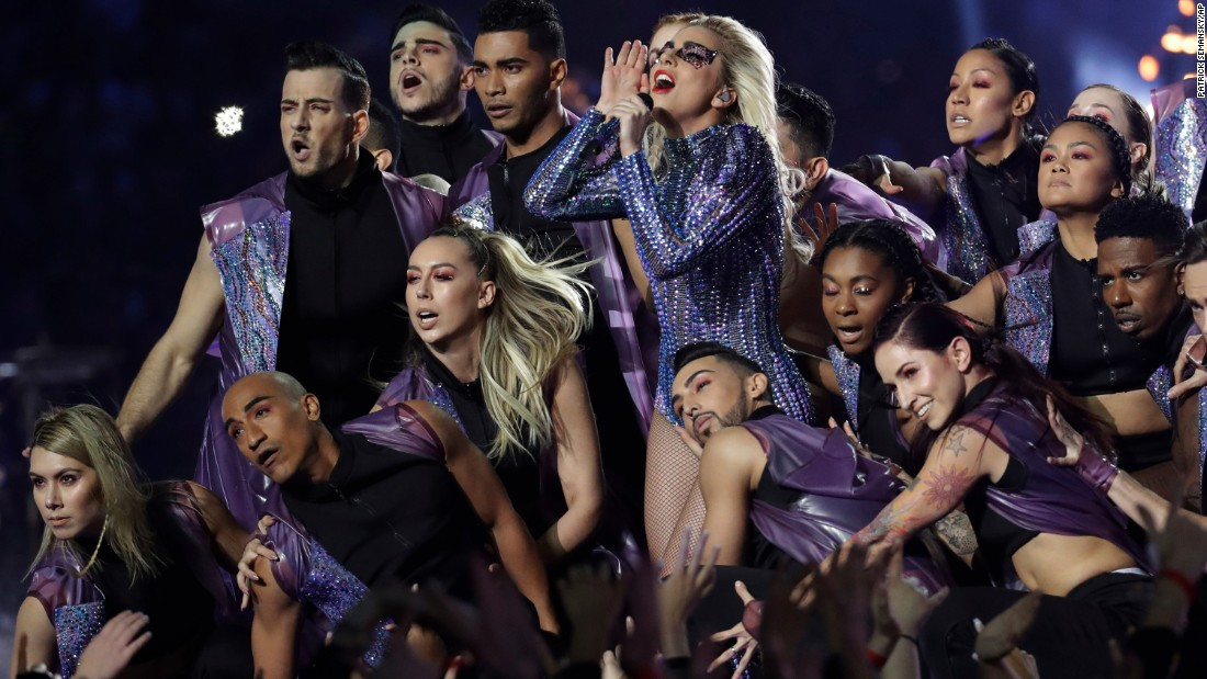 Dancers surround Gaga during the show.