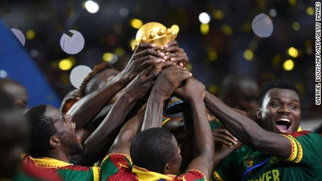 Cameroon team players hold up the winner's trophy as they celebrate beating Egypt 2-1 to win the 2017 Africa Cup of Nations final football match between Egypt and Cameroon at the Stade de l'Amitie Sino-Gabonaise in Libreville on February 5, 2017. / AFP / GABRIEL BOUYS        (Photo credit should read GABRIEL BOUYS/AFP/Getty Images)