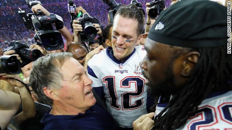 HOUSTON, TX - FEBRUARY 05:  Head coach Bill Belichick, Tom Brady #12 and LeGarrette Blount #29 of the New England Patriots celebrate after defeating the Atlanta Falcons during Super Bowl 51 at NRG Stadium on February 5, 2017 in Houston, Texas. The Patriots defeated the Falcons 34-28.  (Photo by Kevin C. Cox/Getty Images)