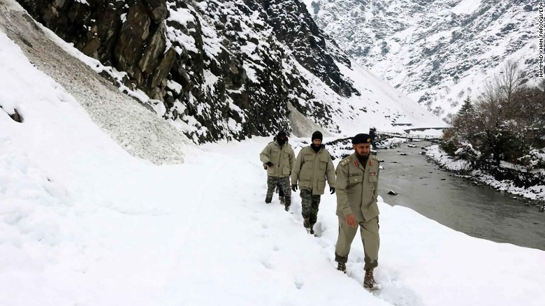 Chitral scouts try to reach the areas in Chitral, Pakistan affected by the avalanche.