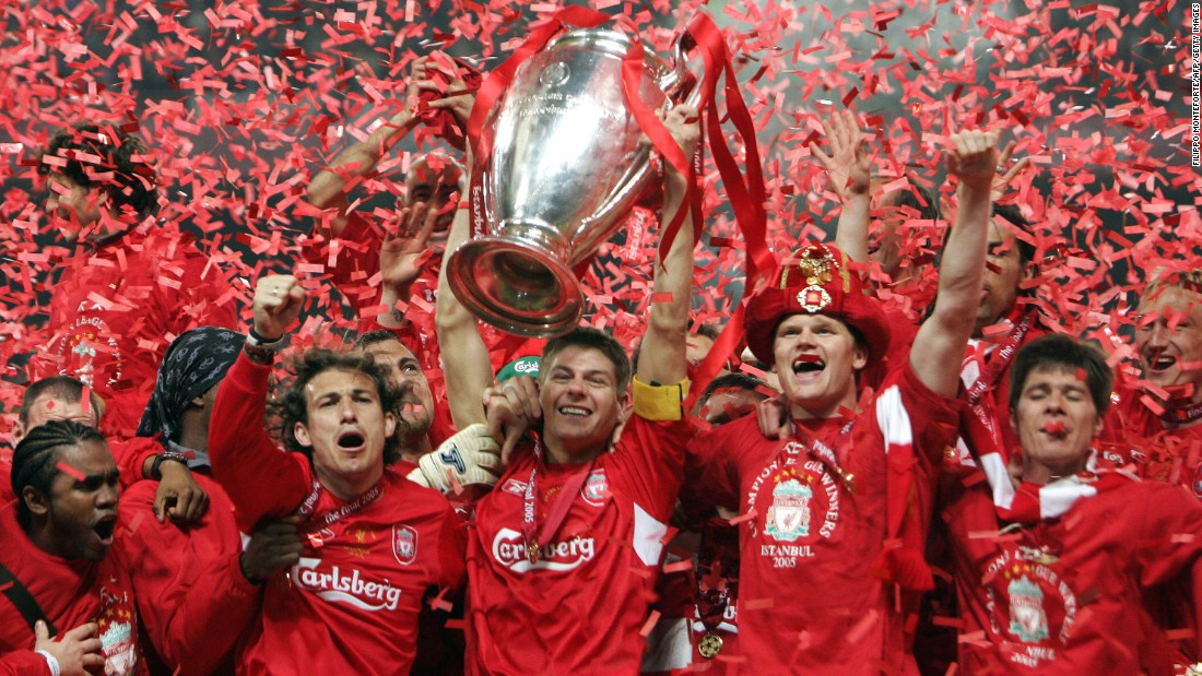 Liverpool captain Steven Gerrard holds the UEFA Champions League trophy aloft after his squad stormed back from three goals down to tie vaunted AC Milan and win on penalties in 2005.