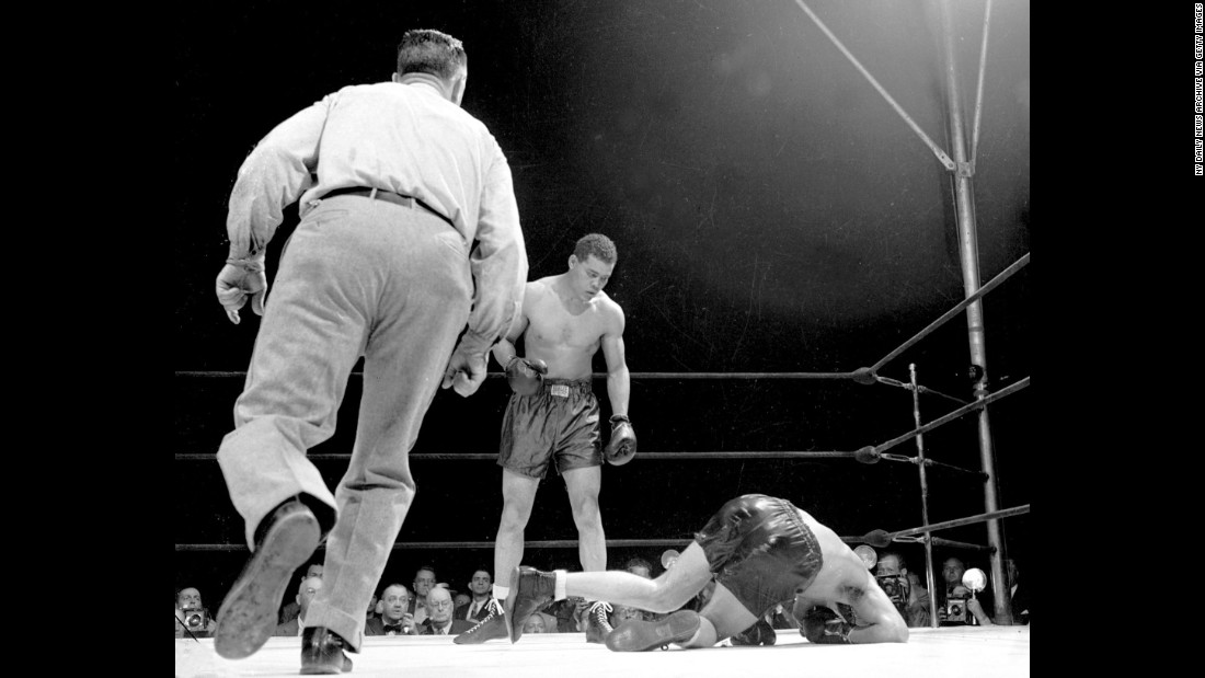 "The Billy Conn-Joe Louis rivalry is one of the greatest in boxing, in no small part due to their 1941 fisticuffs. Through 12 rounds, Conn had the edge on the scorecards -- 7-5, 7-4, 6-6. Louis' trainer, Jack Blackburn, worried that Conn could win by decision, told the ""Brown Bomber"" he had to knock Conn out. And so he did. With 2:58 left in the 13th round, Louis put Conn on the mat to secure his 18th defense of the world heavyweight title."