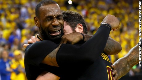 LeBron James (left) and Kevin Love celebrate after winning the 2016 NBA title.