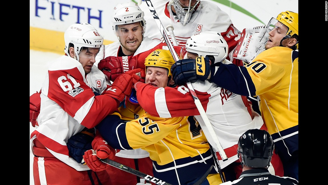 Nashville forward Cody McLeod is mobbed by Detroit Red Wings during an NHL hockey game in Nashville, Tennessee, on Saturday, February 4.