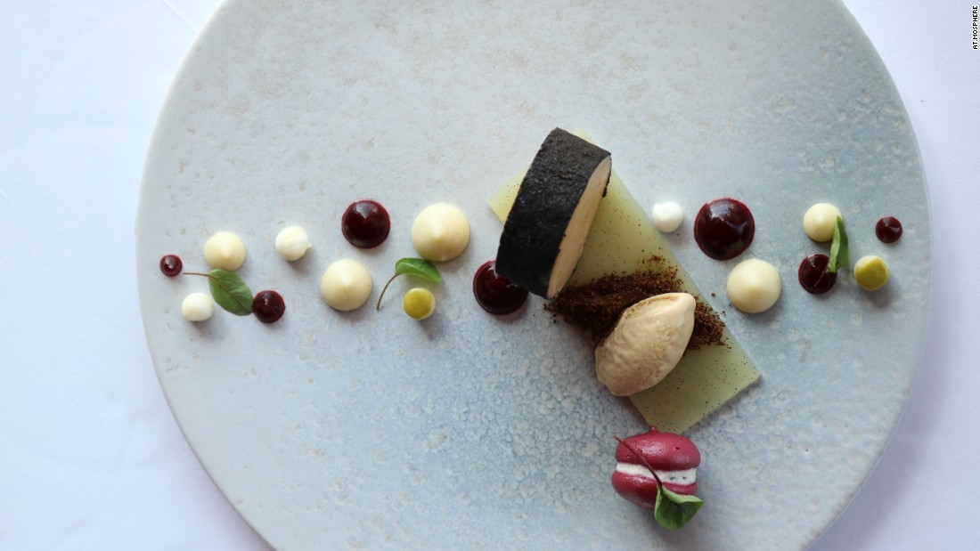 """At.mosphere is excellent. They serve a really impressive menu, and their Japanese scallops with vadouvan, cauliflower, raisins and almonds is presented beautifully. The foie gras, apple, beetroot, apple and vanilla dish is absolutely stunning, too."""