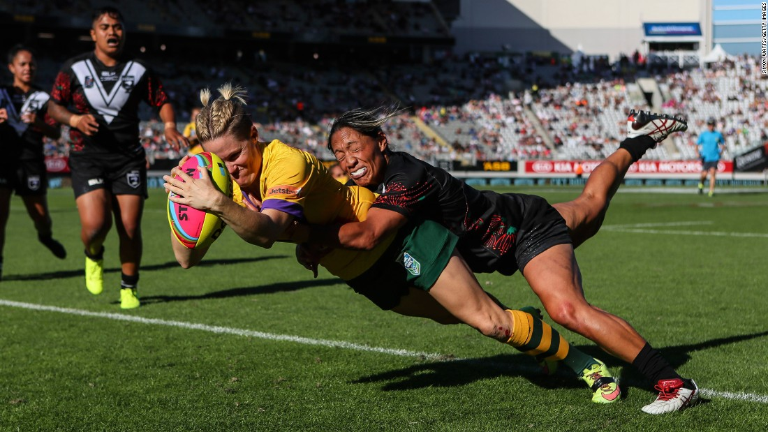 Australia's Chelsea Baker is tackled by New Zealand's Sarina Fiso as she scores a try during an Auckland Nines match in Auckland, New Zealand, on Sunday, February 5. Baker and the Jillaroos swept a three-game series.