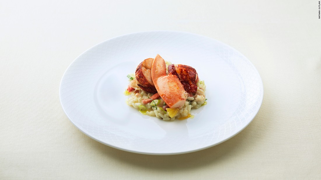 """Order the beautiful lobster risotto featuring carnaroli rice cooked just right, orange segments, scallions, and -- of course -- tender, fiery red lobster."""