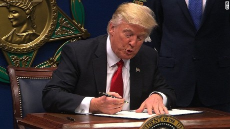 donald trump signs travel order