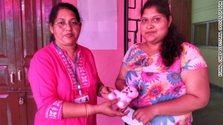 A women voter receives a pink teddy bear.