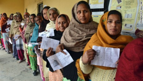 Indian women display their election identity cards outside a polling station, at Chogawan village in the northern Indian state of Punjab on February 4, 2017.