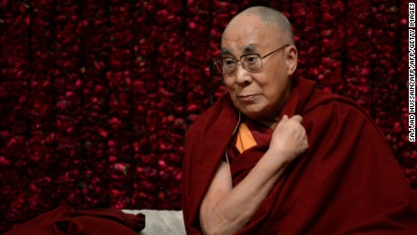 Tibetan spiritual leader, the Dalai Lama, gestures before delivering a public lecture on Reviving Indian Wisdom in Contemporary India at a function in New Delhi on February 5, 2017. / AFP / SAJJAD HUSSAIN        (Photo credit should read SAJJAD HUSSAIN/AFP/Getty Images)
