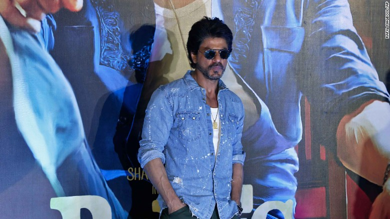 "Shah Rukh Khan poses for press during a trailer launch of ""Raees"" in Mumbai in December 2016."