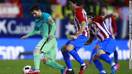 MADRID, SPAIN - FEBRUARY 01: Lionel Messi (L) of FC Barcelona competes for the ball with Nicolas Gaitan (2ndL) of Atletico de Madrid and his teammate Filipe Luis (R) during the Copa del Rey semi-final first leg match between Club Atletico de Madrid and FC Barcelona at Estadio Vicente Calderon on February 1, 2017 in Madrid, Spain.  (Photo by Gonzalo Arroyo Moreno/Getty Images)
