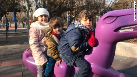 Bana plays in an Ankara park with her two younger brothers.