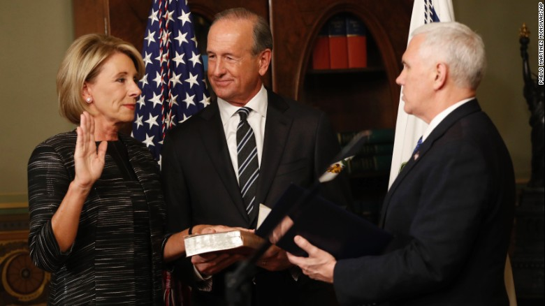 """Vice President Mike Pence, right, swears in Education Secretary Betsy DeVos next to her husband, Dick, on Tuesday, February 7. Pence <a href=""""http://www.cnn.com/2017/02/07/politics/betsy-devos-senate-vote/"""" target=""""_blank"""">cast a historic tie-breaking vote</a> to confirm DeVos after the Senate was divided 50-50."""