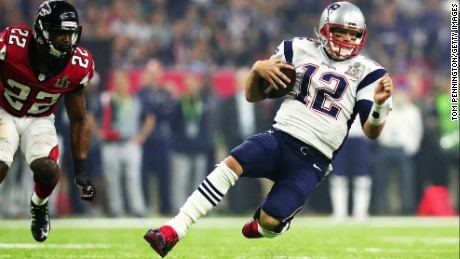 Tom Brady of the New England Patriots runs for a first down against the Atlanta Falcons in the third quarter during Super Bowl 51 at NRG Stadium on February 5, 2017 in Houston, Texas.