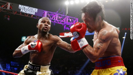 Floyd Mayweather Jr. exchange punches with Manny Pacquiao during their welterweight unification championship bout, May 2, 2015 at MGM Grand Garden Arena in Las Vegas, Nevada.