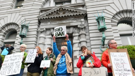 Protesters stand in front of the United States Court of Appeals for the Ninth Circuit in San Francisco, California on February 7, 2017. A federal appeals court heard arguments on Tuesday on whether to lift a nationwide suspension of President Donald Trump's travel ban targeting citizens of seven Muslim-majority countries.