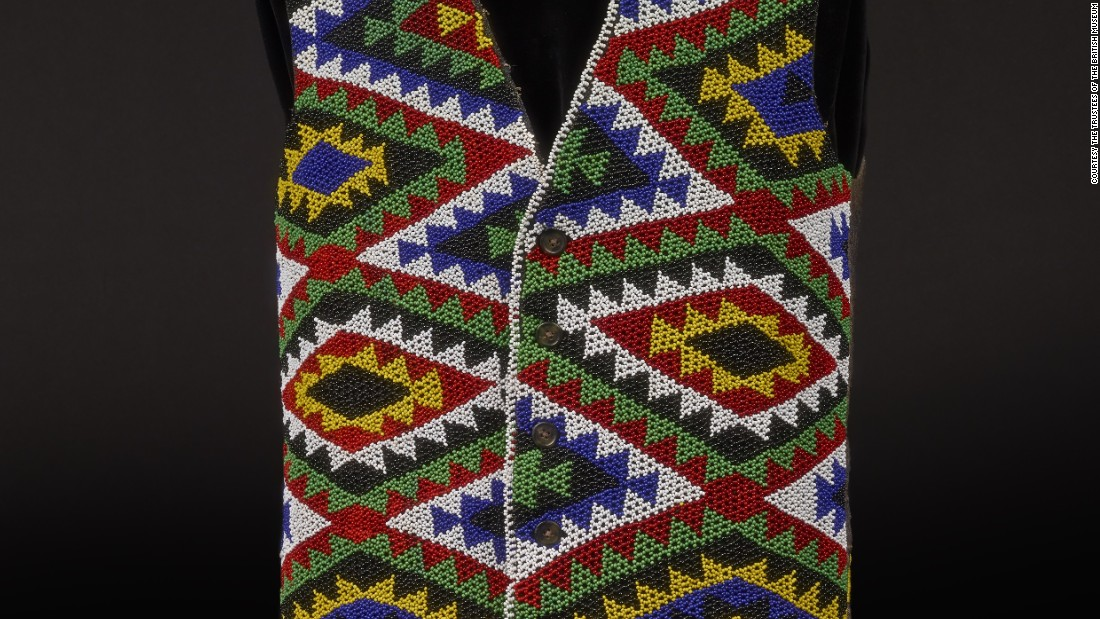 This Zulu beaded waistcoat, is made of glass and wool, and is thought to have been created before 1987 in South Africa.