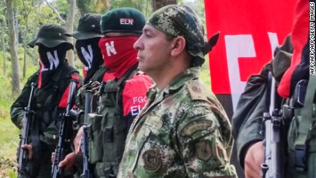 Colombian Soldier Fredy Moreno (R) who was kidnaped by National Liberation Army (ELN), is seen next to ELN members, before his release in Arauca, Colombia on February 6 2017.   Colombia's ELN rebels freed soldier Fredy Moreno Mahecha in a rural area of Arauca department, in a new goodwill gesture on the eve of peace talks to end a 53-year conflict, the Red Cross said.  / AFP / Daniel Martinez        (Photo credit should read DANIEL MARTINEZ/AFP/Getty Images)
