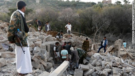 Yemenis search under the rubble of damaged houses following a reported Saudi-led coalition strike in Sanaa on February 1.